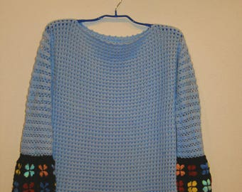 blue crocheted tunic with flower pattern