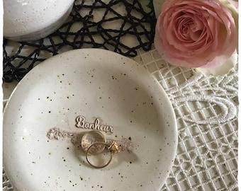 A pretty round dish ceramic stoneware jewelry holder