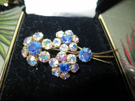 Lovely vintage gold metal pink AB and blue rhinestone flower brooch