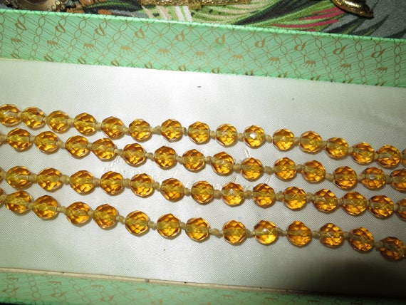 Lovely Vintage Art Deco faceted amber glass hand knotted flapper necklace