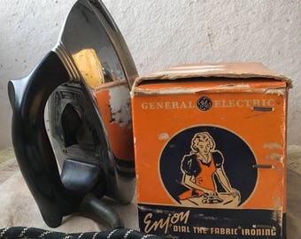 """General Electric Automatic Iron featuring """"Dial the Fabric"""" Temperature control"""
