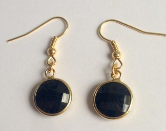 Earrings with Golden edges and faceted, round, black glass bead