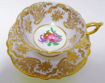 Paragon simply exquisite gold gilt tea cup and saucer MAUVE pastel rose center antique english
