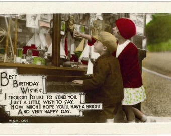 Vintage 1920s birthday card, children, toy shop window, sailing boats, old W&K postcard, RPPC, hand coloured real photograph, birthday poem