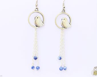 Dangling Silver earrings with charm bird and blue beads