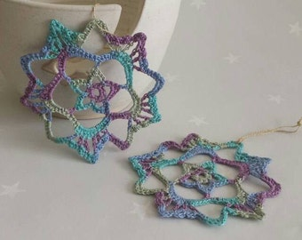 Lace snowflakes, multicolour christmas crochet lace snowflakes in purple blue and green. Xmas decoration, lace snowflake, festive ornament