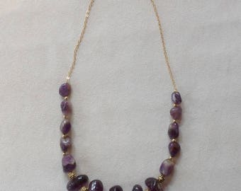 Necklace with Amethyst beads interspersed with antique gold on gold chain.