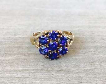 Vintage synthetic sapphire cluster ring in yellow gold