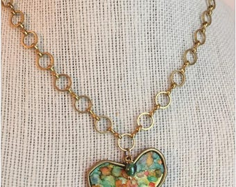 Polymer Clay and Alcohol Ink Gold Whimsy Heart Pendant with Glass Bead on a Gold Circle Chain.