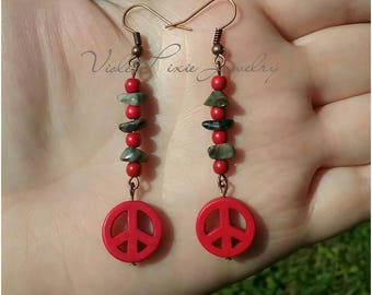 Red and grey peace sign earrings.