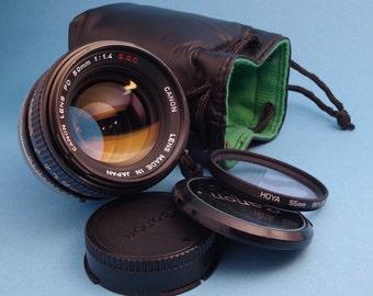 Canon FD 50mm f/1.4 lens + caps + pouch and filter(s)