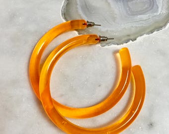 Synthetic clear orange hoops
