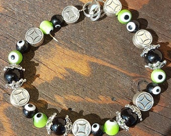 """7in. Handmade sliver and glass beaded bracelet with """"evil eye"""" amulet beads and lobster claps"""