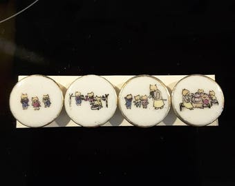 Vintage set of 4 1940's nursery rhyme buttons.