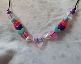 "Necklace ""no"" in a heart"