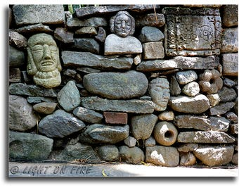 PRINT #20: Unusual Mayan looking Stone wall built with rocks and stone carvings.