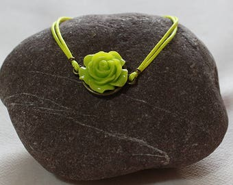 Neon yellow polyester wax cord bracelet with green flower cabochon