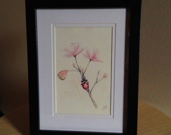 Framed watercolour painting print of a ladybird/ladybug on a flower