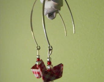 earrings with red origami boat