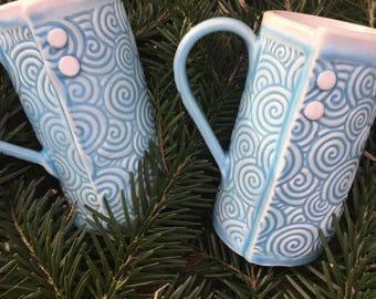 Blue swirl button mugs