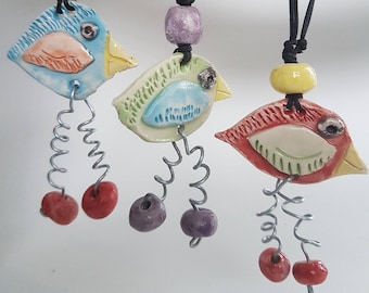 Crazy Bird Hand crafted Ceramic / wire  one of a kind pendant.