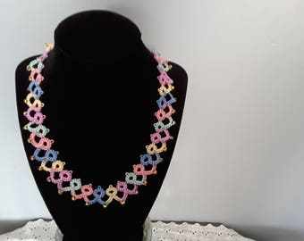 Multi color 20 inch tatted necklace. Has gold tone beads as assents.
