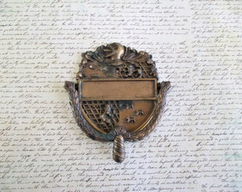 Vintage Knight and Coat of Arms Knocker