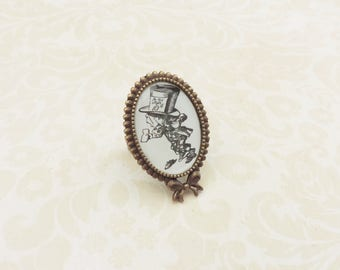 The Mad hatter adjustable ring with a picture of Alice in wonderland book on bronze bow setting