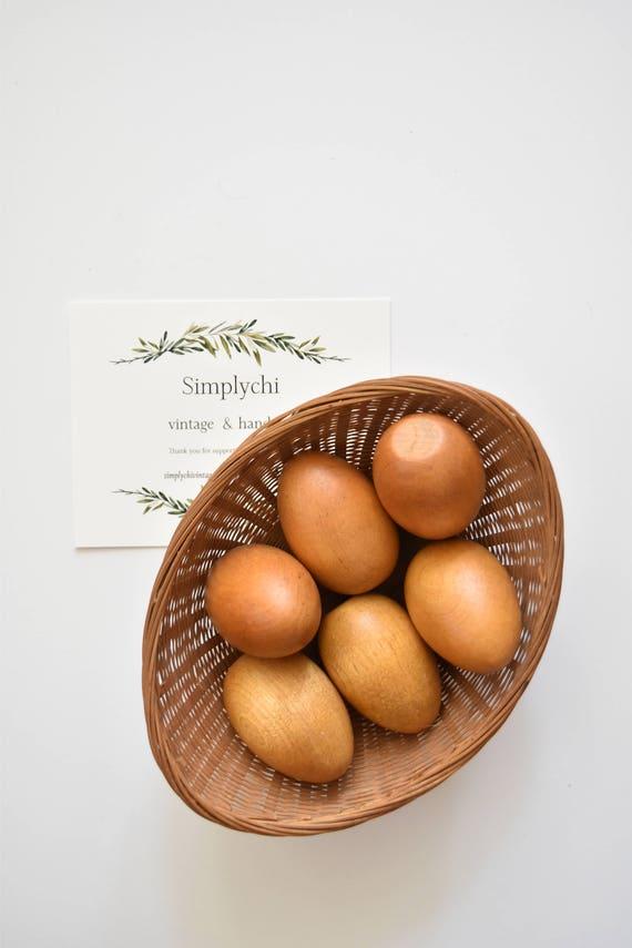 vintage basket of wooden eggs