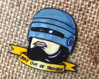 Robocop 'stay out of trouble' pin badge