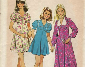 Sewing pattern Simplicity 6186 Girls dress empire line with puffed sleeves variations and flared skirt Size 10