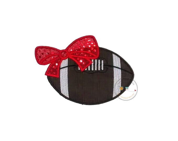 Football with red sequin bow applique