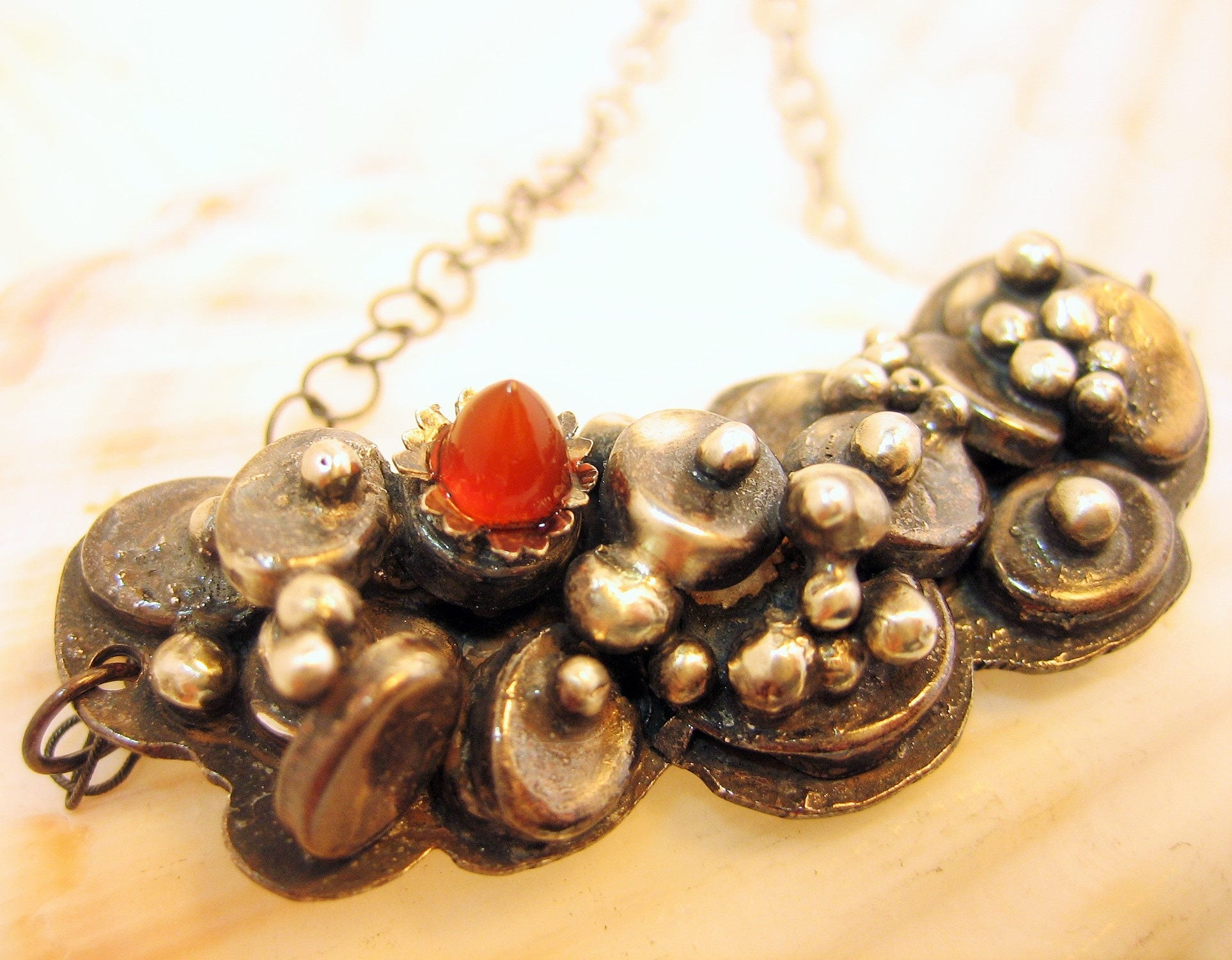 Blackened silver pod necklace with red carnelian, blackened silver artisan necklace, pod necklace, barnacle necklace, black and red necklace