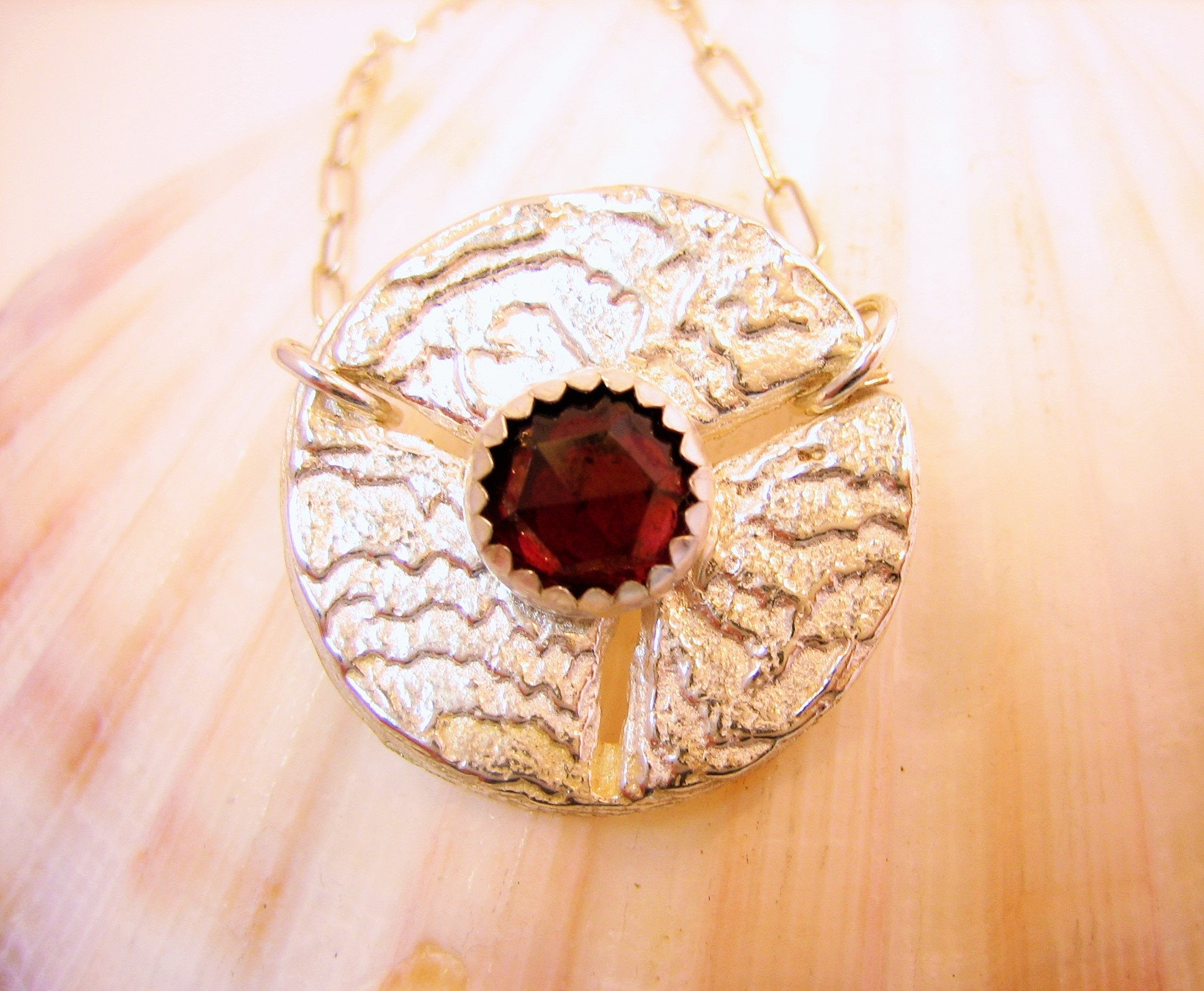 Red garnet on unique sea coin silver pendant, silver sea sponge inspired pendant, sea dollar silver necklace, silver and red gem necklace