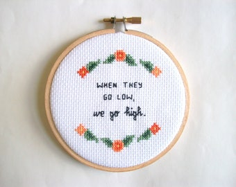 "When they go low, we go high cross stitch -- completed 4"" hoop cross stitch"