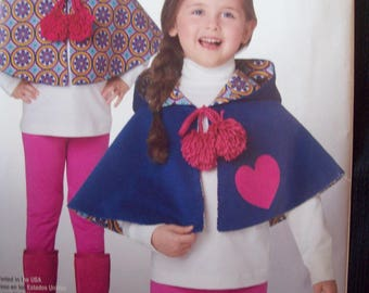 It's So Easy Child's Reversible Poncho Simplicity Pattern A8006 Uncut Sizes S-L