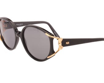 Nina Ricci Paris ladies oversized sunglasses in black with golden bow hinges, NOS 1980s