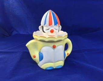 Vintage 1930s ceramic clown reamer & juicer pitcher. Hand painted in Japan, Mikori ware. Yellow, red, blue.