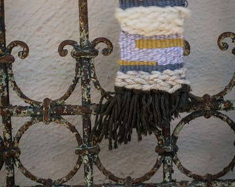 Cream and gray woven wall-hanging
