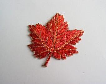 Fusible application embroidered orange leaf pattern