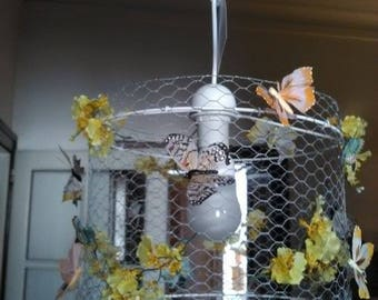 Chandelier in wire with a swarm of butterflies and yellow flowers