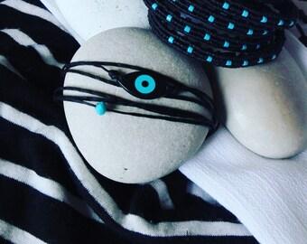 Black wrap around evil eye bracelet