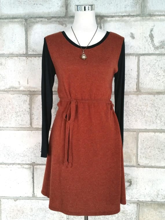 The Clementine wool and merino knit stretch dress in orange rust.