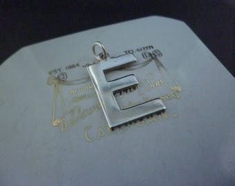 """A polished silver Letter 'E' pendant - 925 - sterling silver - 1"""" x 0.6"""" - Marked 'silver'"""