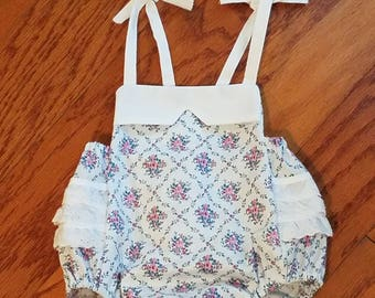 Baby girls floral print frilly romper - available in ages newborn - 18-24 months