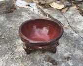 small ceramic bowl in red, black, and tan