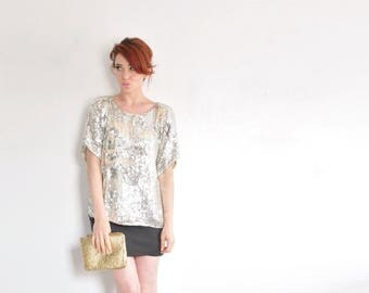 metallic silver sequin blouse . sheer nude cut out flowers ooh la la .medium.large