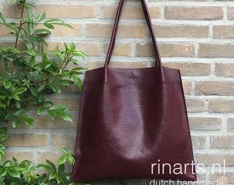 Tote bag Rinarts in veg tanned burgundy red full grain Italian leather. Handle pleated bag. Luxury bespoke leather bag