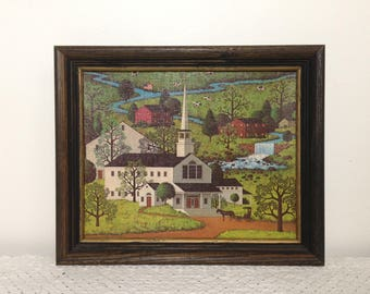vintage Charles Wysocki framed litho canvas art print. Country church, hillside, houses, cows, Amish horse buggy, trees, river & waterfall.