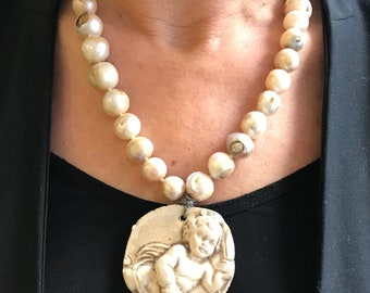 Pearl necklace, Natural pearl necklace with a terracotta medallion.